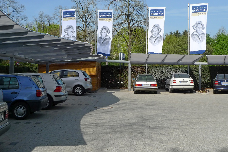 Carports Senioren-Wohnstift Bonn Bornheim Stahlbau Träger gekrümmt Glas geschwungen fertig
