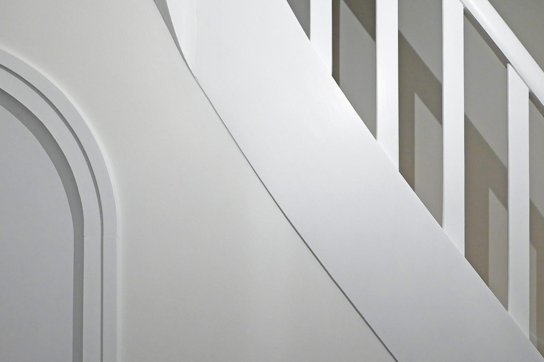 Renovierung Reihenhaus Nymphenburg Treppe mit Geländer